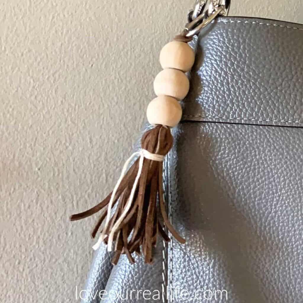 tassel on wood bead keychain attached to purse
