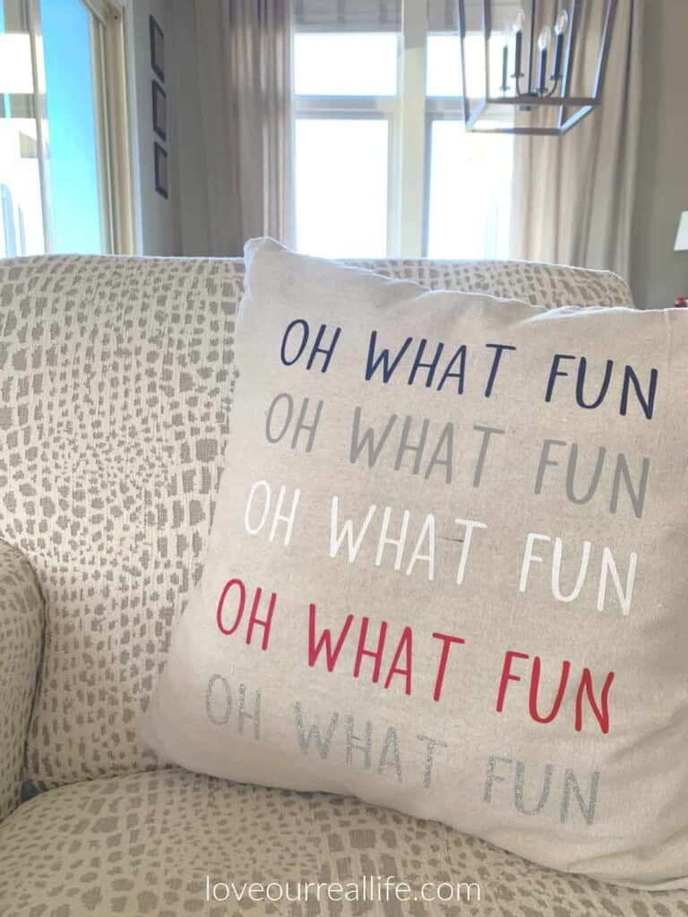 oh what fun Christmas pillow on ivory and gray chair