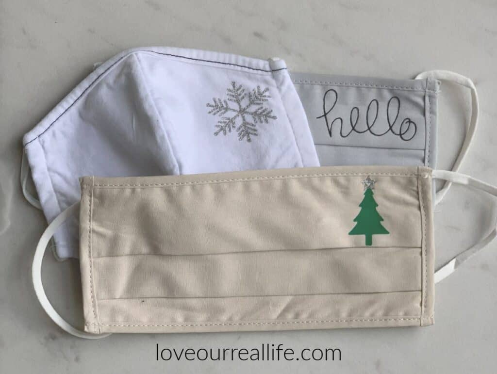 various face masks for covid in white, tan, and gray with Christmas designs