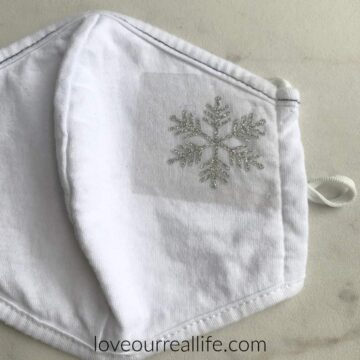 snowflake iron on vinyl decal in metallic silver on face mask