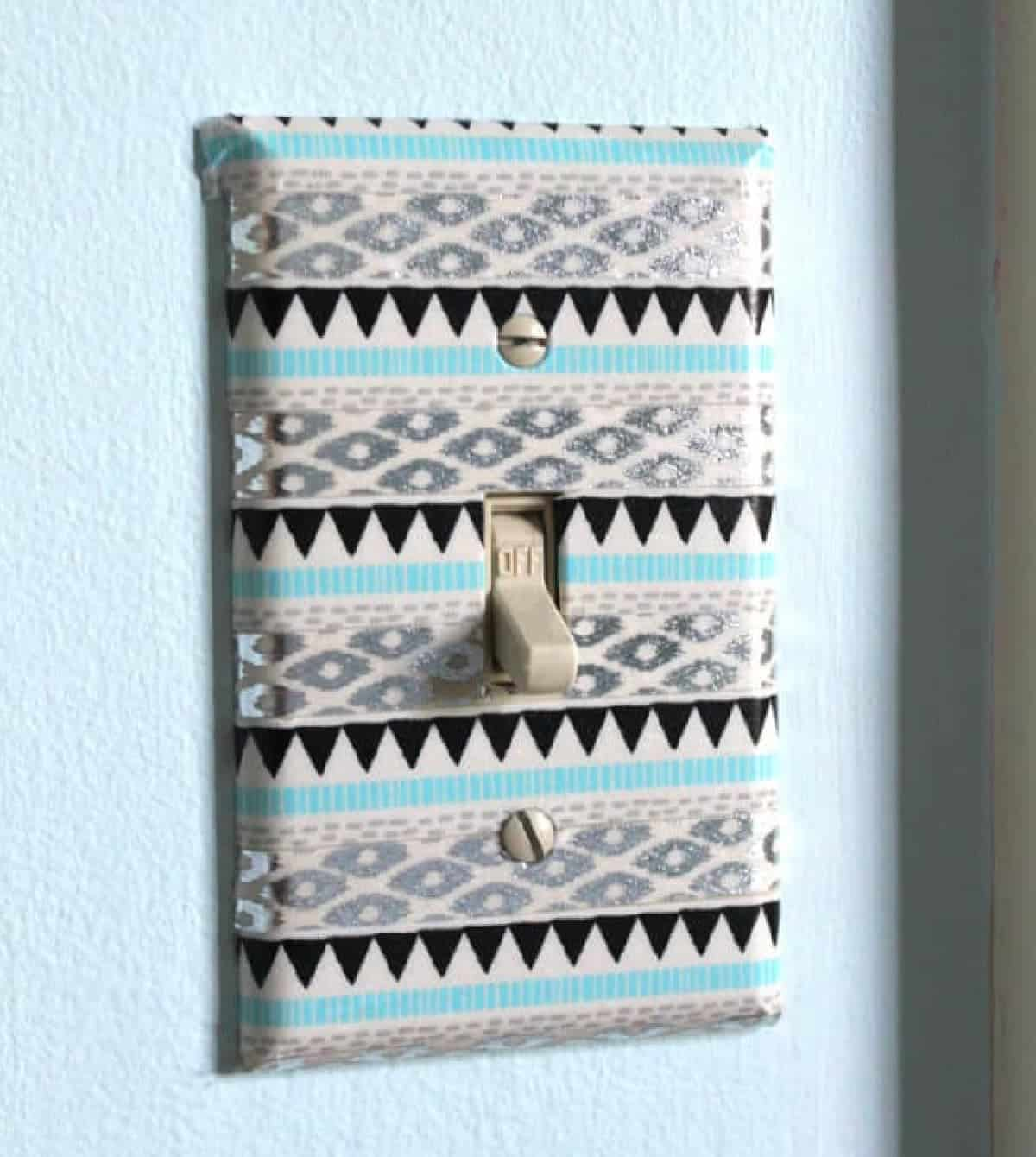 Litch switch covered in blue, black, and gray washi tape in tween girl's bedroom.