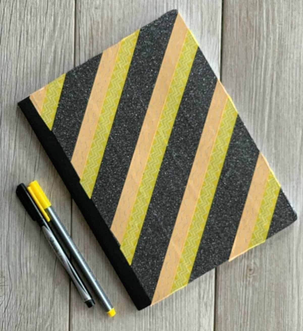Notebook covered in washi tape.