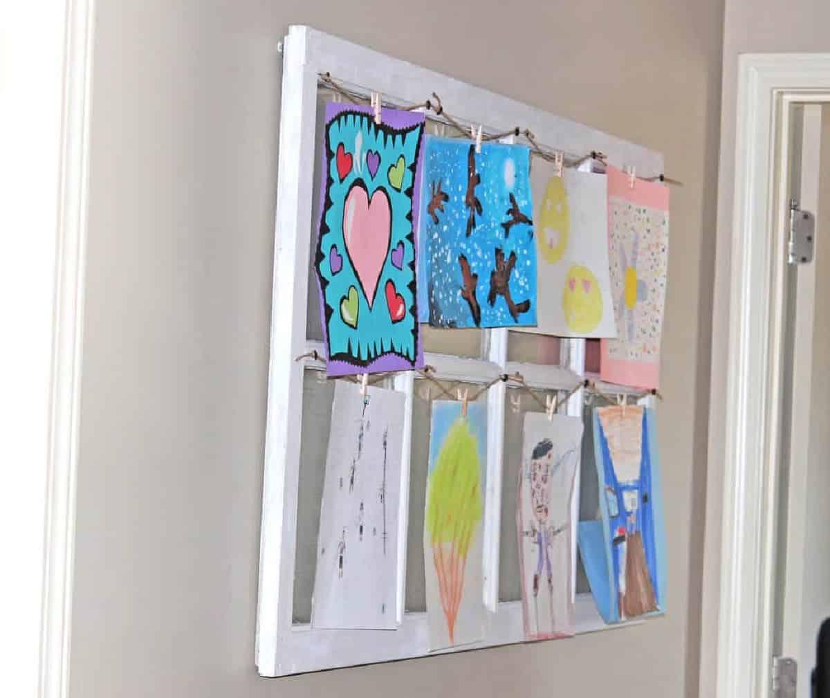 old window repurposed to display kids art