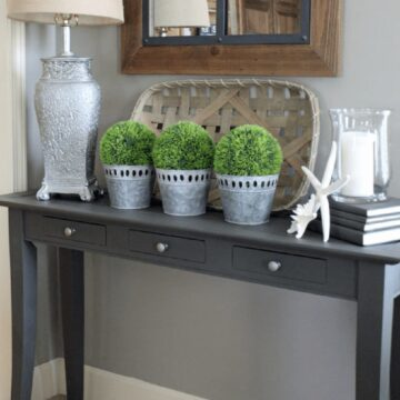 dark gray sofa table with tobacco basket and decor elements