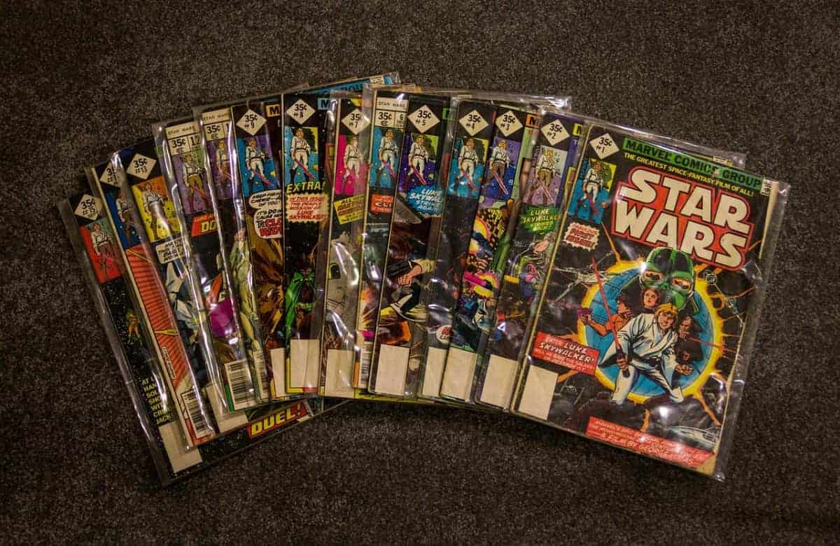 Star Wars comic books in plastic packaging on table.