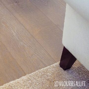 white chair with brown leg on carpet to avoid scratching hardwood floors.